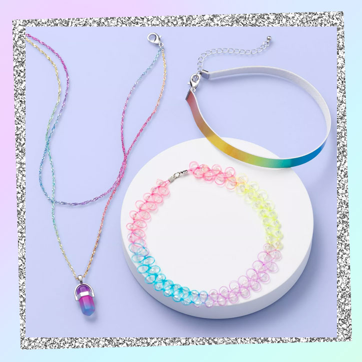 Two rainbow chokers and a crystal necklace with a long rainbow chain