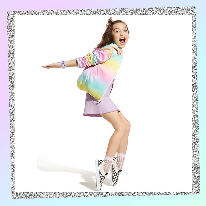Tween girl wearing a rainbow pastel jacket