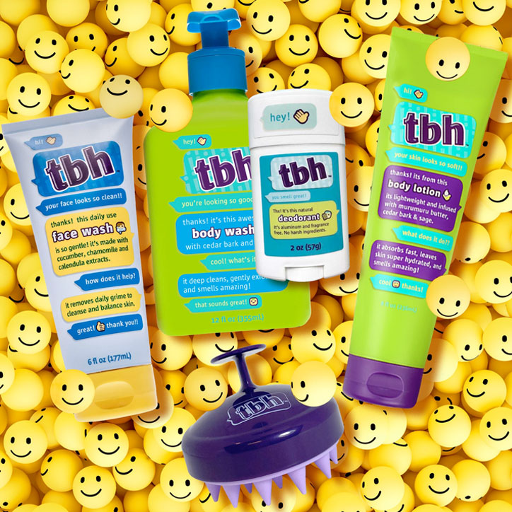 TBH Kids bath and body products laying on a bed of smiley face balls