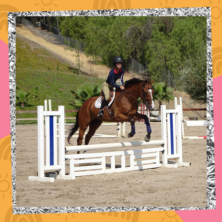 Aubrey Anderson-Emmons performing a jump while riding a horse