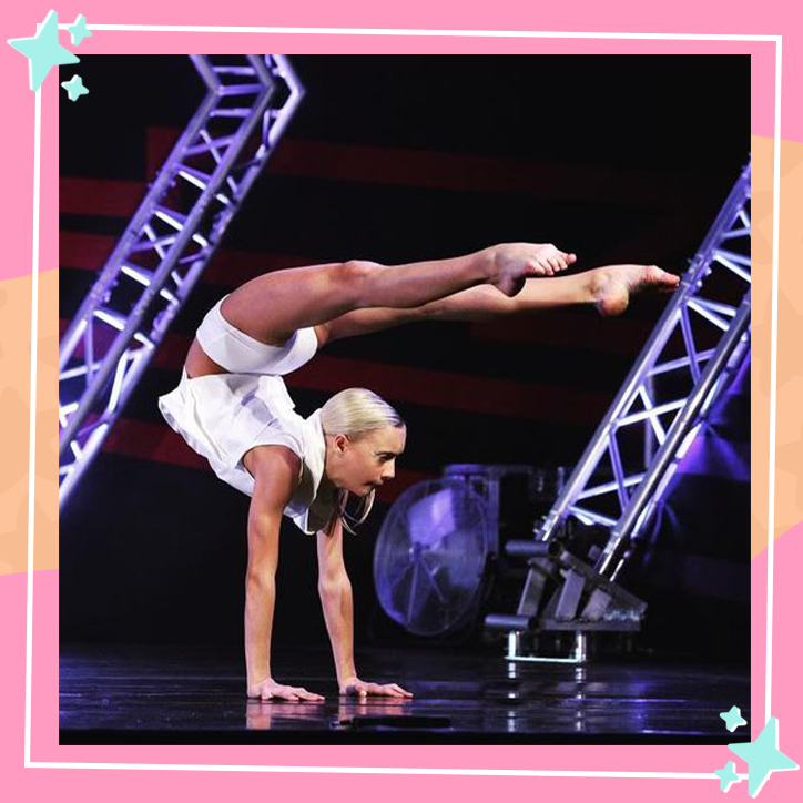 Dancer Katie Couch performing in a competition, balances on her arms while pointing her legs over her head