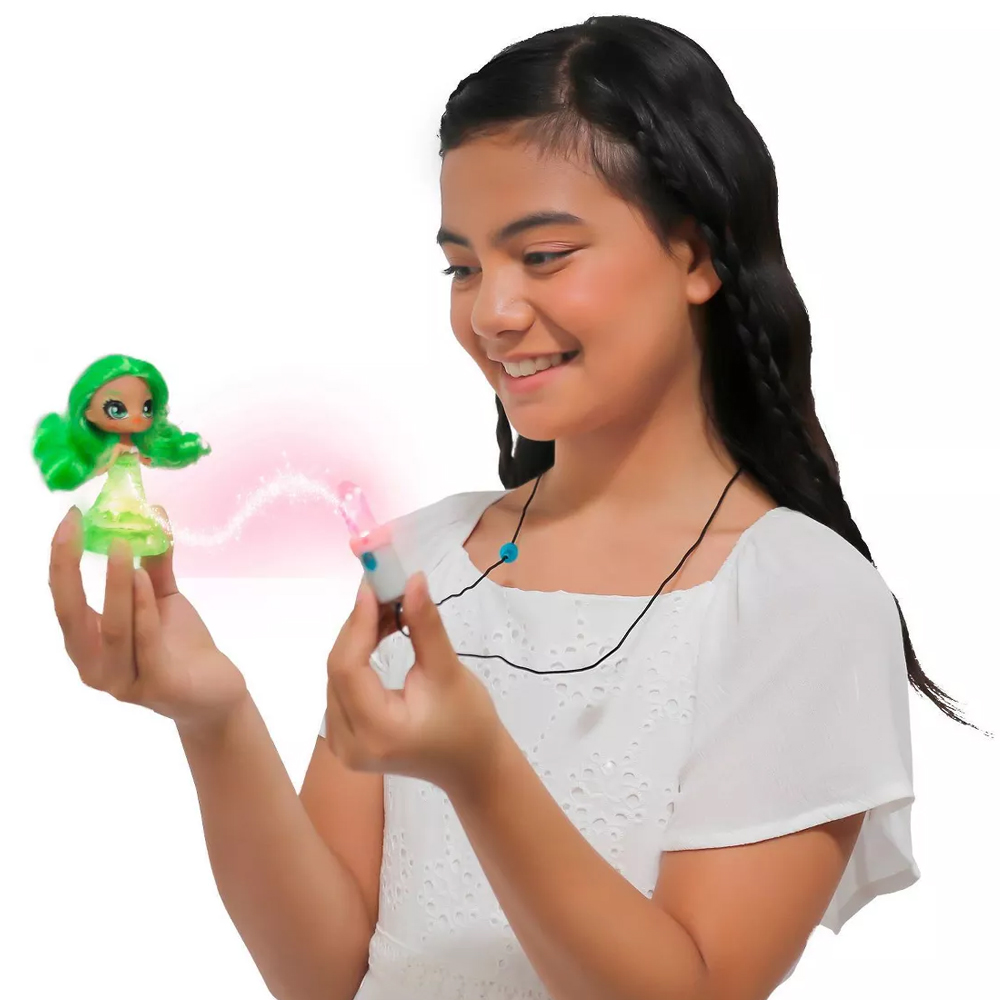Tween girl holding a Crystalina doll showing off the crystal powers between the doll and the amulet