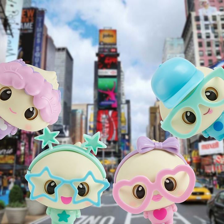 My Squishy Little Dumplings Doe, Dip, Dee, and Dot standing in Times Square