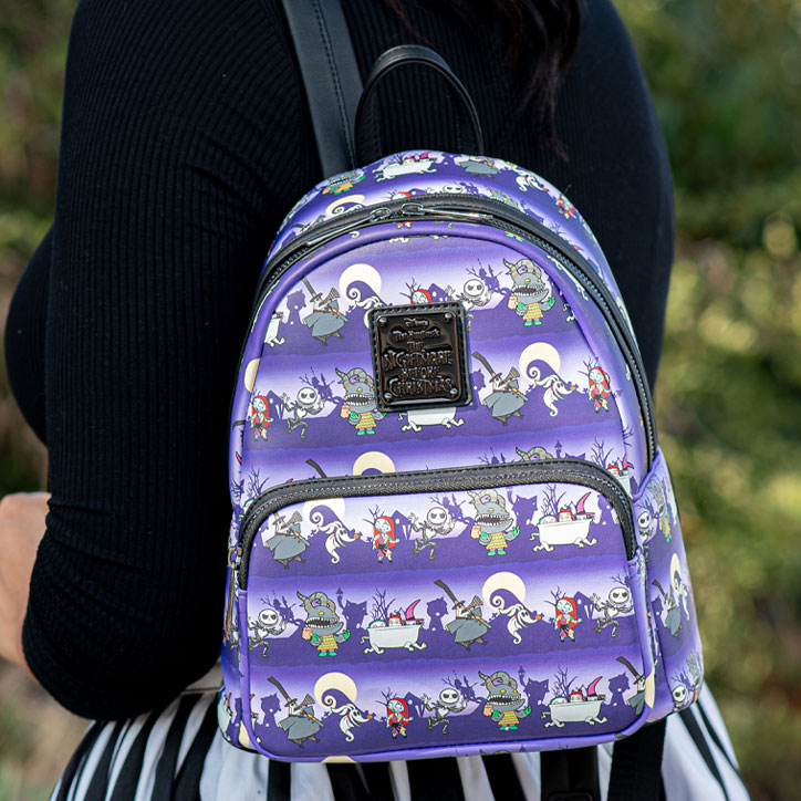 Lifestyle shot of the Nightmare Before Christmas minibackpack draped over a girls shoulder
