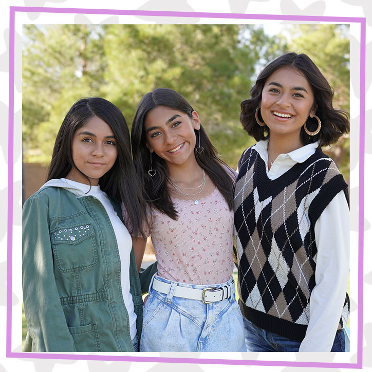 GEM Sisters Evangeline, Mercedes, and Giselle posing together outdoors in fall outfits