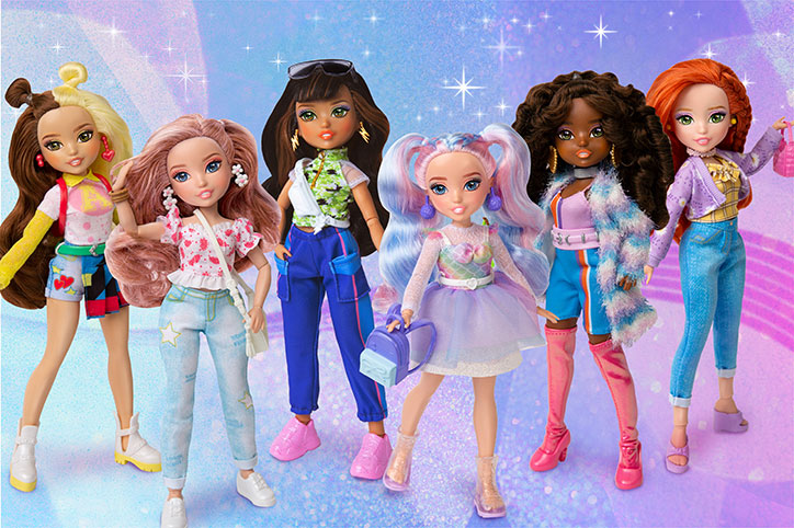 All six GLO-Up Girls dolls standing together in their glo-up outfits on a pretty swirly pink, blue, and purple ombre backdrop