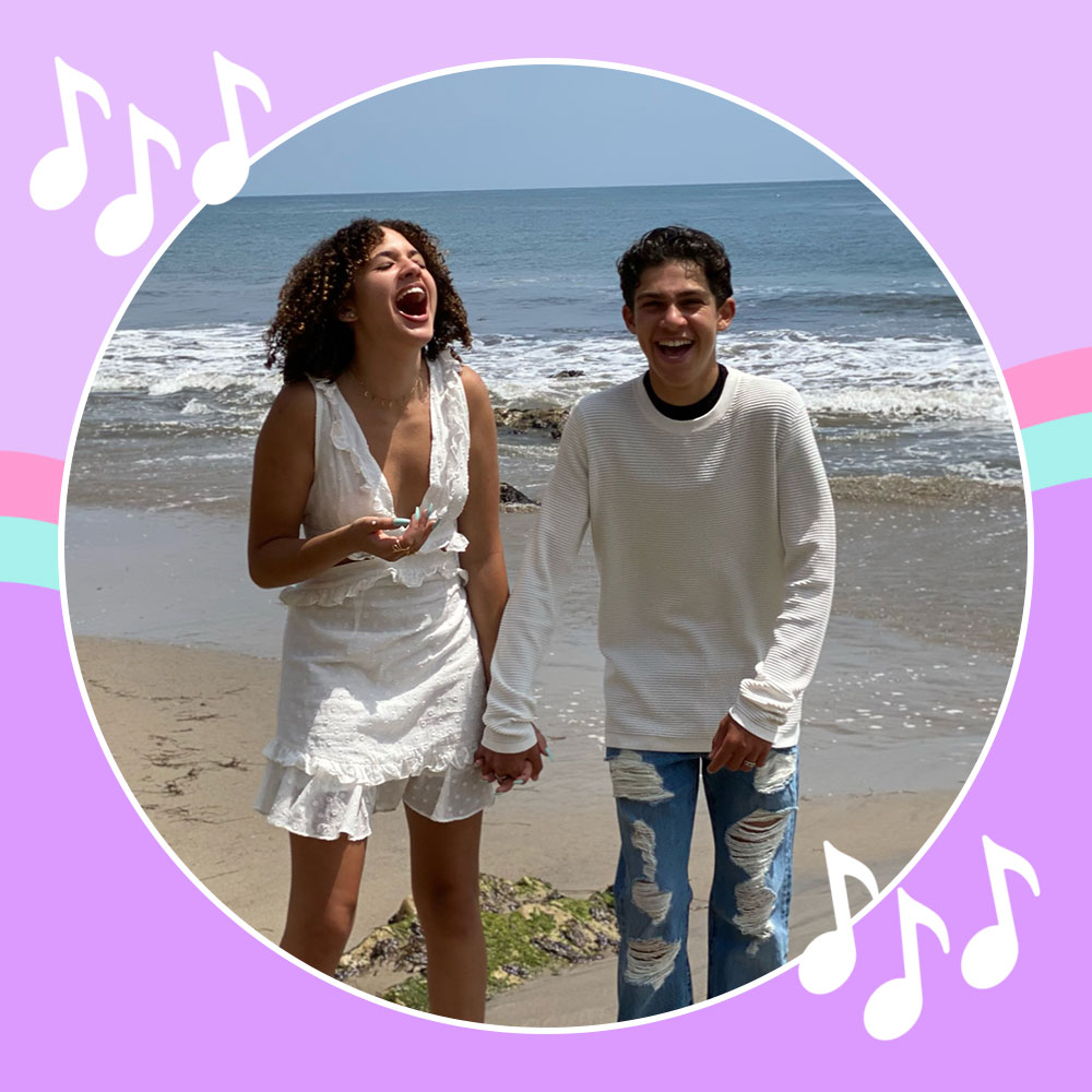 Jackson Dollinger and Scarlet Spencer laughing on the beach