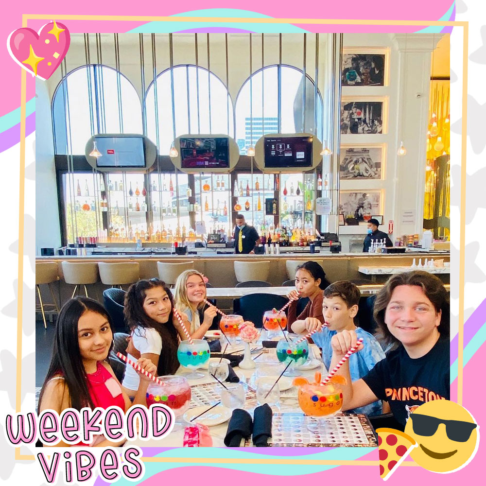 Bryson Robinson and some of the Mani cast sip on fruity drinks in big goblets at Sugar Factory in LA
